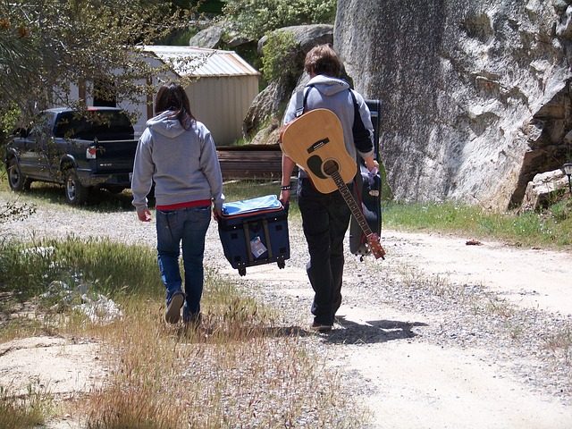 Campers carrying the ice chest