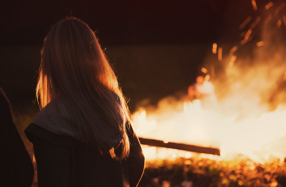 A girl's watching the fire