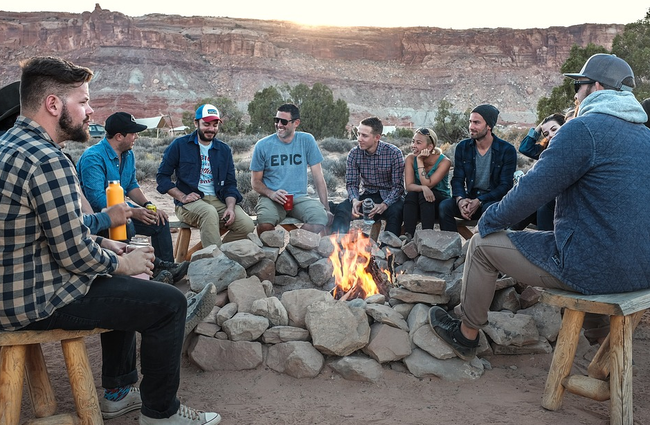 A group of people around the fire