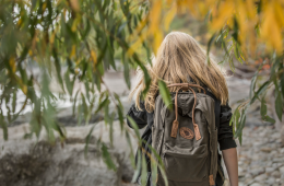 A blonde girl with backpack