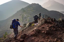 People backpacking on a mountain