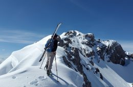 A skier going up the mountain